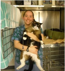 Animal hospital tech with fat cat